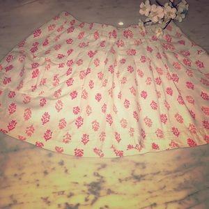 Print pleated mini w fuchsia & lite pink on cream